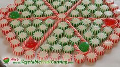 Learn the secrets to making a serving plate from candy canes at http://www.vegetablefruitcarving.com/blog/christmas-candy-platters