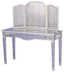 "Rosedale Vanity and Samantha Mirror by Lillian August for Drexel Heritage   Height: 30""; width: 49""; depth: 18""; material: antiqued beveled glass in silver-mirror finish with 24.5""-high beveled three-panel mirror; $969. Mirror, $419.  - ELLEDecor.com"