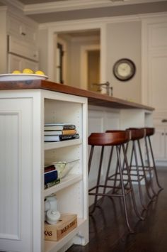 kitchen bar -- AND STOOLS CAN GO COMPLETELY UNDER THE COUNTER AND ON BOTH SIDES.