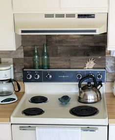 I love the idea of the reclamed wood for a kitchen splashback .. Its just that if I did this I'd have mine embedded and made into resin tiles for hygiene!
