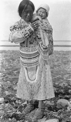 Inuit woman wearing an amauti and carrying a child on her back : N.W.T. [Nunavut], ca. 1926-1943. Credit: D.B. Marsh / Library and Archives Canada