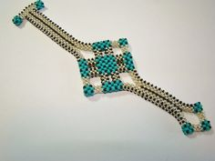 Silver and Turquoise Cubic Right Angle Weave by ABeadingObsession