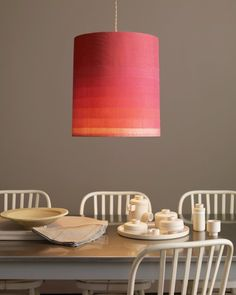 DIY - how to make an ombre light using strips of overlapping cotton voile wrapped snugly around a straight-sides, inexpensive shade. The fabric is translucent so light shows through.
