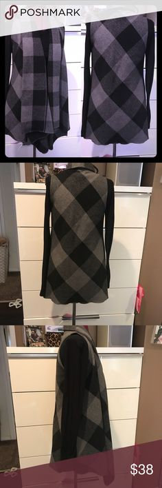 Women's Sleeveless Draped Checkered Shawl Don't miss out on the chance to own this beautiful Checkered draped front jacket/shawl. Does not come with black sleeve shirt. Sz med Jackets & Coats
