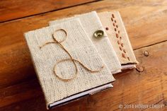 Easy DIY gift idea: hot glue burlap to an inexpensive journal and then add embellishments for a personal touch.