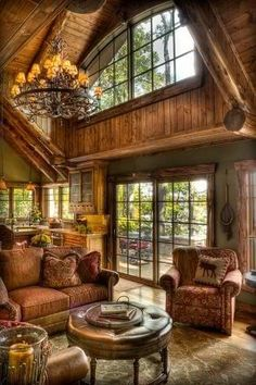 Log cabin living room, I like the wood with the painted walls.