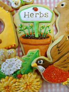 """Part of a """"Cookie Garden"""" arrangement designed for a tiered glass display. Vanilla Butter Cookies with Royal Icing by Robin Traversy {The Cookie Faerie}."""