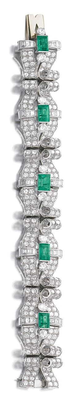 EMERALD AND DIAMOND BRACELET, CIRCA 1950 The scroll work links set with circular-cut and baguette diamonds, highlighted with step-cut emeralds, length approximately 850mm