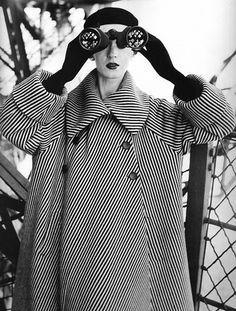Balenciaga striped coat photographed at the Eiffel Tower by Richard Avedon. Model: Dovima.