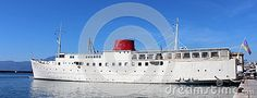 Old white ship restored and turned into a floating hotel called botel and docked in port of town Rijeka, Croatia.