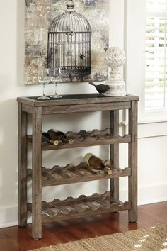 Vennilux wine racks's cool inset tabletop gives glasses and decanters a place to perch. Three racks put 18 bottles within easy reach. Weathered gray undertones finesse the simple yet substantial design.