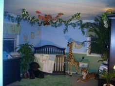 Baby Boy's Jungle Themed Nursery Decor in Blue, Green and White: We decided to decorate our baby boy's room with jungle themed nursery decor.  As you can see from the jungle nursery pictures, we took our cues for the