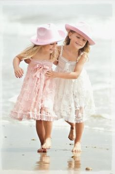 Seaside girls ...adorable. - a bit staged but still very cute - would they really have on these dresses at beach?