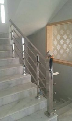 If its filling is perforated consisting of balusters fixed at an equal distance Modern Staircase balusters consisting distance equal Filling Fixed Perforated Steel Bed Design, Steel Stairs Design, Steel Grill Design, Home Stairs Design, Wooden Staircase Railing, Modern Stair Railing, Modern Stairs, Stainless Steel Stair Railing, Steel Handrail