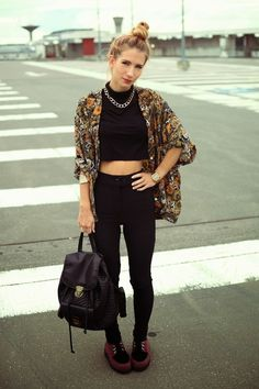 A kimono with a high neck crop top and skinny jeans/leggings