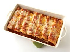 Chicken Enchiladas : Tyler tops chicken-stuffed tortillas with a chile-laced enchilada sauce and a mix of cheddar and Jack cheeses, then bakes them until the cheeses are warm and melted. To finish this Mexican-style meal, he garnishes the platter with cool sour cream and chopped fresh tomatoes.