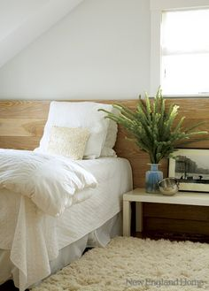 half wall - love this idea - use reclaimed wood for an attic bedroom?