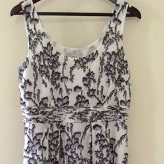"""Ann Taylor Loft Dress NWT Size 10 This dress has empire waist with beautiful raw edge fabric detailing. It is brand new with tags and never worn. It measures 19"""" across the bust and has a zipper under the arm. The length from the shoulder is 38"""". LOFT Dresses Midi"""