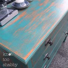 Two-color distress using Chalk Paint by Annie Sloan in Barcelona Orange and Florence, sealed with clear wax.