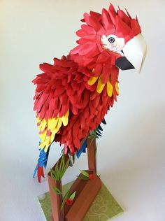 paper model of Macaw on stand.
