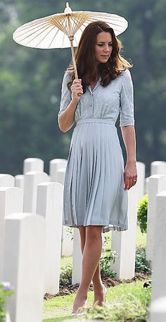 The Duchess of Cambridge gave her first international speech at Hospis Malaysia wearing Jenny Packham's pleated, periwinkle dress with three-quarter sleeves. She accessorized her look with L.K. Bennett heels and a pretty parasol.