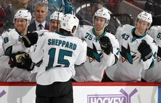 The San Jose Sharks bench congratulate forward James Sheppard on his first goal of the season (Oct. 27, 2013).