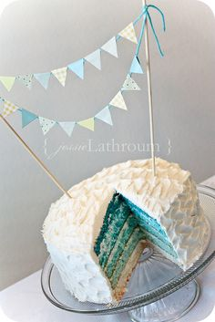 Exactly what I want for gender reveal cake but with pink blue bunting on top and ombre of baby gender inside. Yay for baby Brantner : )