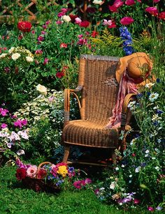 Antique Wicker Rocking Chair in a Flower Garden summer home flowers garden plants pond gardening ideas vegetable garden outdoor projects raised beds