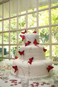 White Wedding Cake Decorated with Teal, Purple & Green (instead of Red) butterflies