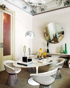 El Palauet Living Barcelona Hotel | marble table Saarinen Platner chairs Arco lamp Achille Castiglioni