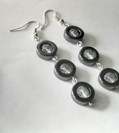 Hematite and crystal earrings Three hematite hoops by DesignbyRAE, $30.00