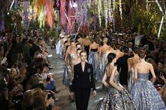 Models present creations for Christian Dior during the 2014 Spring/Summer ready-to-wear collection fashion show, on September 27, 2013 in Paris. AFP PHOTO / FRANCOIS GUILLOT