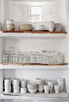 Open shelving. Love the natural wood incorporated with painted white cement. Great nook!