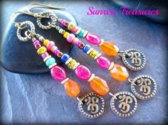 ~ Colorful natural gemstone earrings with brass Ohm charms. ~  STONES: vibrant smooth natural pink rubies, softly faceted orange carnelians and natural turquoise. BEADS: multi colored glass seed beads and African brass rings. I used antiqued brass wire to form these pretty dangles for you. Each dangle end dances with cute double sided brass Ohm charms. These beaded dangles swing from ribbed antiqued brass rings. I finished these off with simple hand formed brass hooks. MEASURE: just over 2…