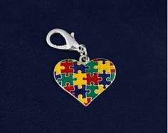 Multicolored Puzzle Piece Heart Hanging Charms. These colorful autism puzzle piece heart hanging charms are approximately 1 inch x 1 inch with a clasp. Packaged 25 hanging charms per pack. Product Code: HCHARM-95-2