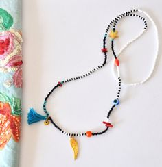 Wing and tassel beaded necklace black and by NataliesWunderland, $40.00