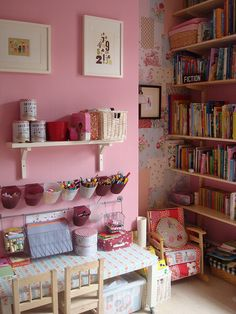 Patchwork wallpaper in alcove, kids craft table, reading nook - pretty and functional girls room