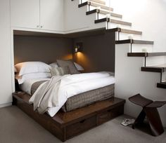 Bed under the stairs.