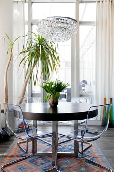 ikea electic dining table arctic pear chandelier colourful rug transparent glass chair wooden table flower vase tall window of Dazzling Arctic Pear Chandelier to Hang at Your Home