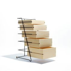 "These wooden drawers on a light metal frame are by Tokyo designer Keiji Ashizawa. Called Slybox, the piece of storage has five draws of decreasing size. Each has grooves in the sides, which slot onto the frame made of bent steen rods. ""This drawer uses the box which have simple detail as possible in minimum"