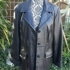 Beautiful leather coat! Leather coat by Dennis Basso. Three buttons and two flap pockets. Cuff sleeves. Has slight imperfection interior.  See photo please.  Never worn Dennis Basso  Jackets & Coats