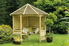 Venetian Corner Arbour | Forest Garden Unique venetian style slatted roof design lets light in but keeps showers out.  Seats 4 people.  A place to relax or shelter from the weather. #arbours