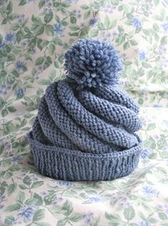 Swirl knit hat.  This pattern is worked flat on two needles.  Would like to adapt for in the round.