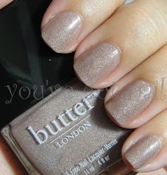 I love butter LONDON's All Hail McQueen. It has a brown base with swathes of gold and pink through it. This is a fabulous color, because shades that are nearly the same as your skin color make your fingers look longer and thinner. I like this one, because the shade is classic and ladylike, but the sparkle shows you aren't just following the crowd. It's a 'spark' of individuality. The shimmer is subltle, sexy & elegant. Sophisticated.