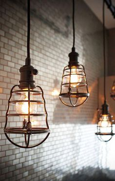 Vintage-style cage lights. They make terrific accent lamps for bar.