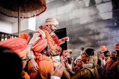 Pin Down These Trendy And Unique Varmala Exchange Ideas For Couples. For more such wedding inspiration, stay tuned with shaadiwish. Candid Photography, Wedding Photography, Indian Groom, Wedding Groom, Hiking Boots, Wedding Inspiration, Couples, Grooms, Balloons