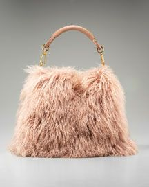"""I want this so that when I walk around I can pet it and say """"Give me my wallet. Give. Give. Leave it! Give! Good purse."""""""