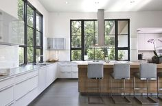 Bright Modern White Kitchen with Stainless Steel Appliances