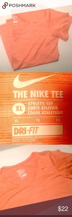 Coral striped Dri fit Tee, size xl Beautiful coral colored dri fit, V neck Tee.  The dri fit allows breathability and pulls sweat away from your skin.  Athletic cut and very flattering.  I'm great shape with light striping and a coral Nike sign. Great match for any season work out gear Nike Tops Tees - Short Sleeve