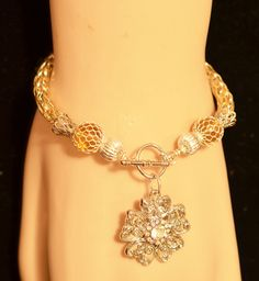 Multi Colored (Gold/Siler) Single Weave Viking Knit Bracelet with Flower Pendant $28.00  http://creationsbyjennilee.com